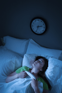 a woman with insomnia symptoms